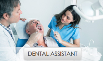 Young Female Dental Assistant Working with Dentist on Patient's Mouth